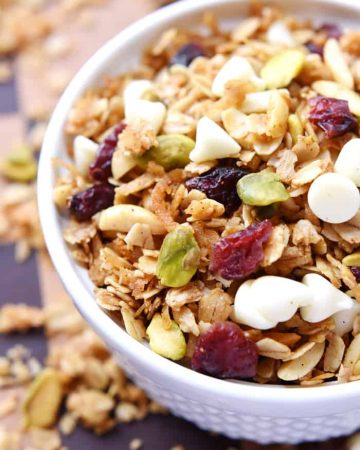 Close-up of Gingerbread Granola with Cranberries, Pistachios, and White Chocolate Chips.