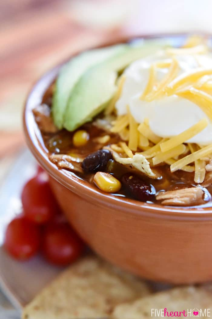Close-Up of Bowl with Toppings of Corn, Beans, Sour Cream, Cheese and Avocado
