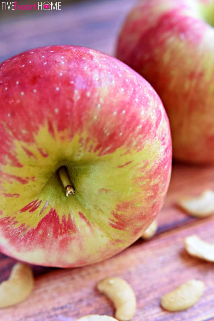 Close-Up of Beautiful Fall Apple with a Sprinkling of cashews