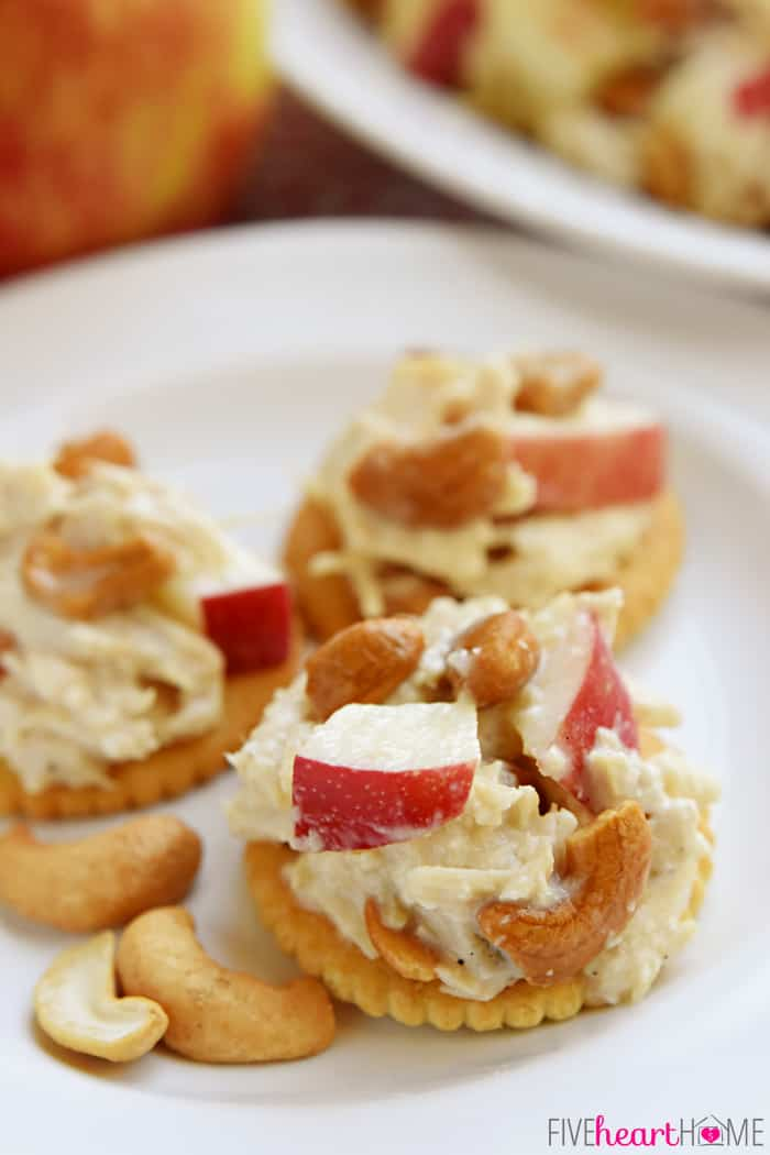 Chicken Salad with Apples and Cashews on Butter Crackers Served on a White Plate