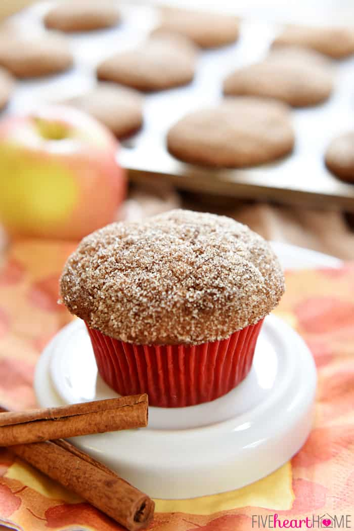 Whole Wheat Apple Cinnamon Muffins are soft and moist, bursting with tender apples, made wholesome by whole wheat flour and coconut oil, and topped with a cinnamon sugar coating | FiveHeartHome.com