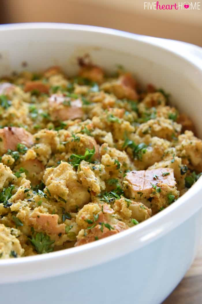 Cornbread Stuffing with garlic and herbs in baking dish.
