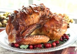 Maple-Glazed Turkey with Bacon and Sage Butter ~ tender, juicy, and shingled with bacon, this is the BEST Thanksgiving turkey recipe you'll ever try! | FiveHeartHome.com