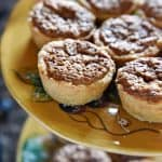 Mini Pecan Pies ~ flaky, tender crust requires no rolling and the nutty, sugary filling calls for only 5 ingredients, making these a perfect addition to your Thanksgiving dessert table! | FiveHeartHome.com