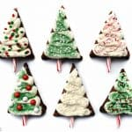 """Christmas Tree Brownie Pops ~ fudgy brownies, tangy cream cheese frosting, candy cane """"trunks,"""" and lots of festive sprinkles make these Christmas cookies perfect for decorating with kids, filling a holiday cookie platter, giving as food gifts, or leaving for Santa! 