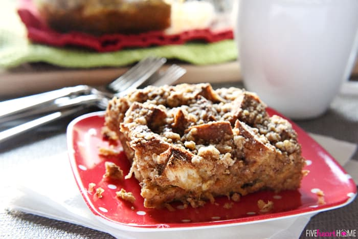 Overnight Gingerbread Baked French Toast Casserole with Streusel Topping on Red Holiday Plate with Coffee