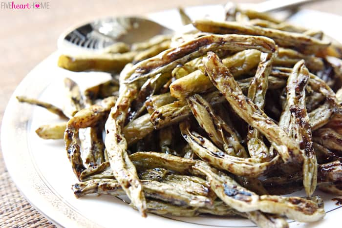 Roasted Balsamic Green Beans on a Silver Rimmed Platter with Serving Spoon
