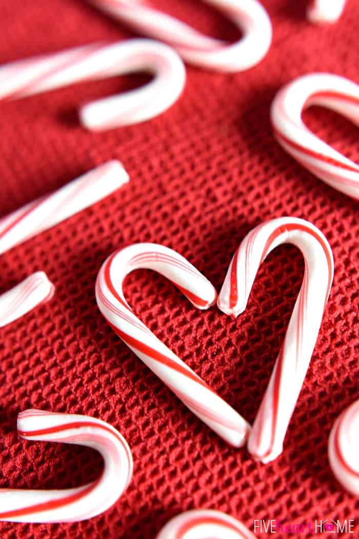 Peppermint Canes formed into a heart on a red cloth