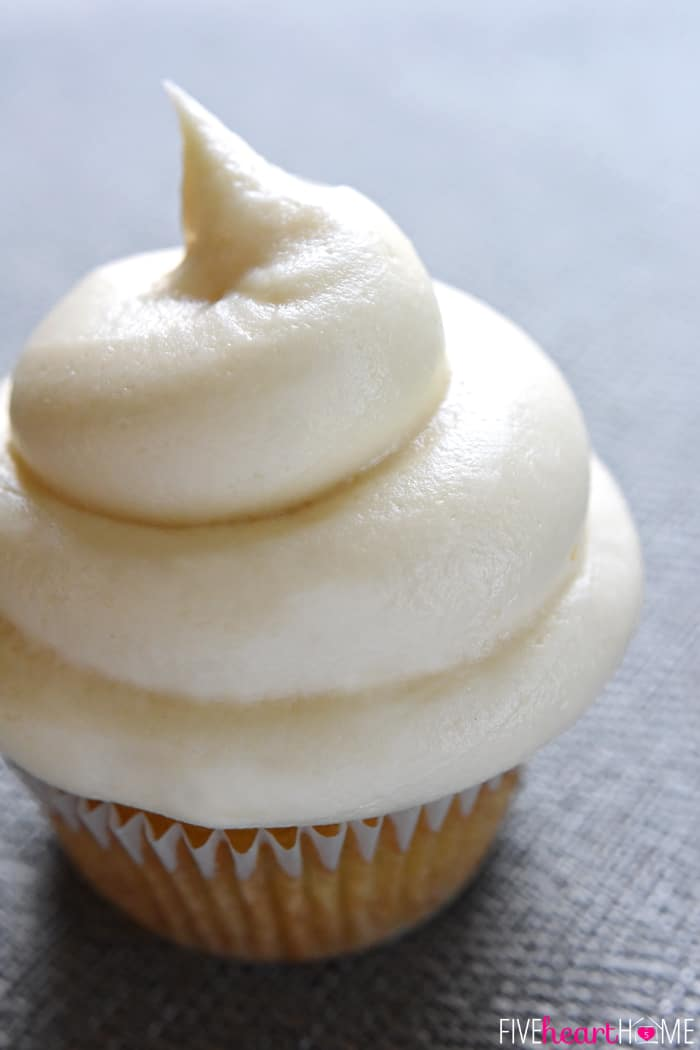 A cupcake topped with a perfect swirl.