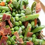 Creamy Spring Peas with Bacon + Mint ~ this ultimate Easter side dish features a delicious combo of flavors and textures from sweet green peas, fresh sugar snaps, salty bacon, a decadent cream sauce, and refreshing pops of mint   FiveHeartHome.com