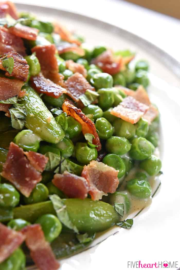 Creamy Spring Peas with Bacon + Mint ~ this ultimate Easter side dish features a delicious combo of flavors and textures from sweet green peas, fresh sugar snaps, salty bacon, a decadent cream sauce, and refreshing pops of mint | FiveHeartHome.com