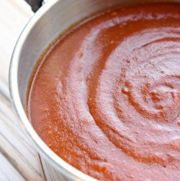 Homemade Enchilada Sauce in a saucepan.