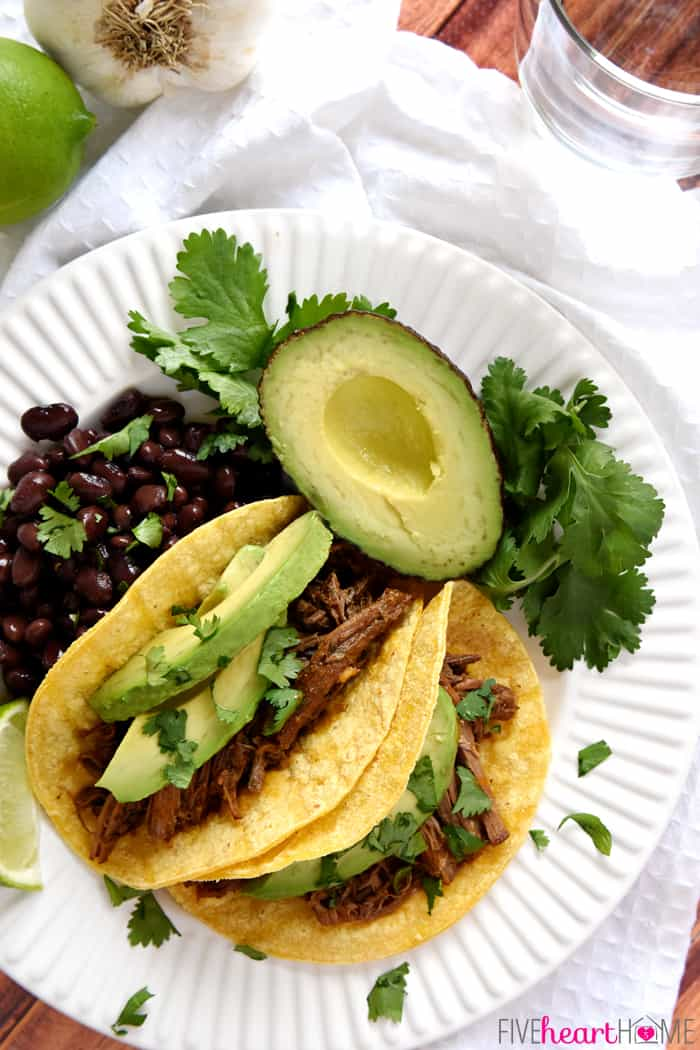 Barbacoa Recipe on White Plate with Black Beans