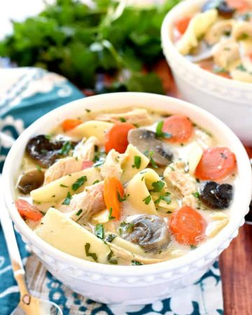 The BEST Slow Cooker Chicken Noodle Soup ~ wholesome and easy to make, this crock pot soup is extra flavorful thanks to a few secret ingredients...and it's the perfect get-well-soon recipe for making it through cold and flu season! | FiveHeartHome.com