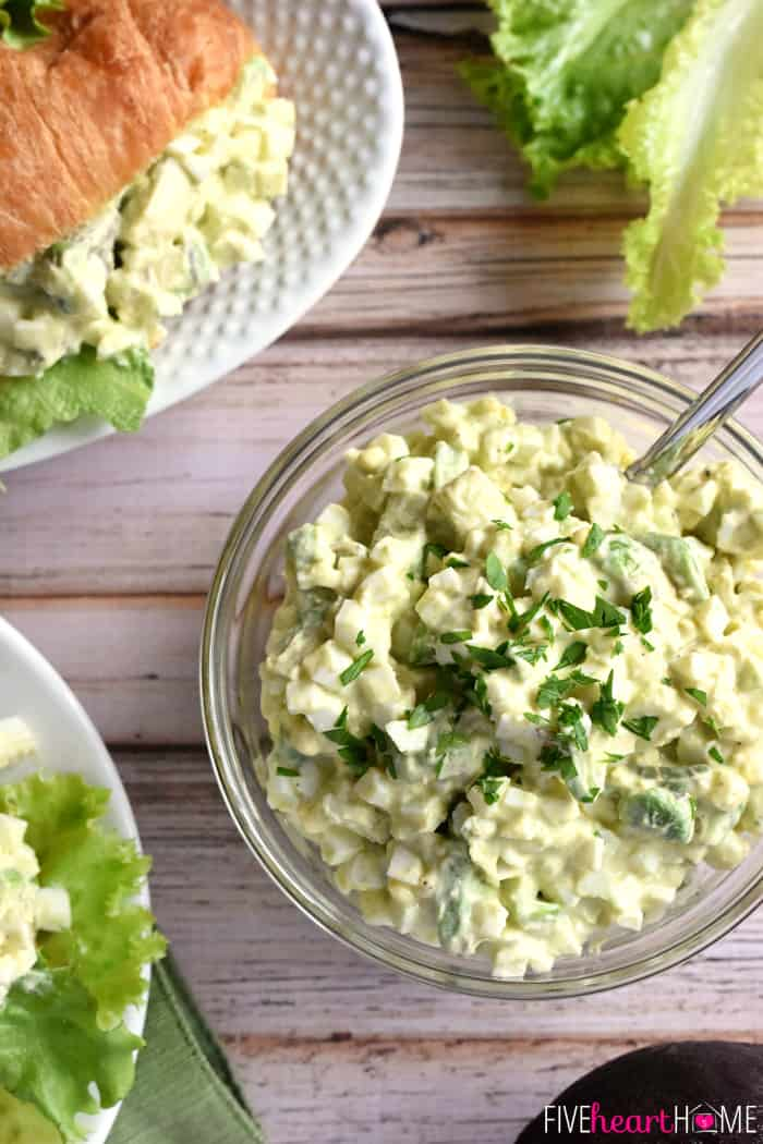 Aerial view of Avocado Egg Salad in bowl and on croissant.