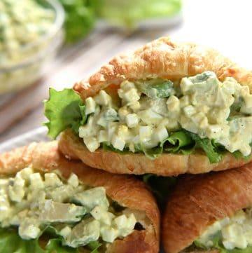 Avocado Egg Salad in croissants on serving platter.