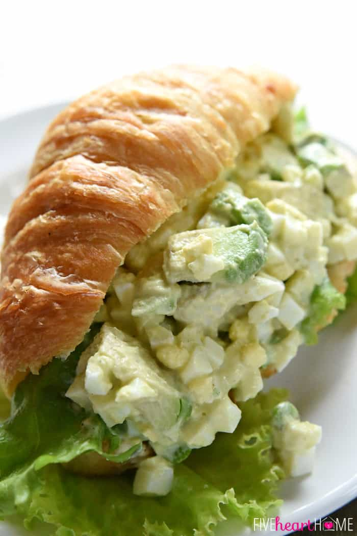 Croissant overflowing with egg salad