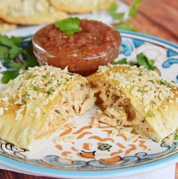 Creamy Chicken Taco Hand Pies ~ crescent roll dough filled with a savory mixture of diced chicken, cream cheese, taco seasoning, and fresh cilantro, and topped with a crunchy layer of crushed tortilla chips | FiveHeartHome.com