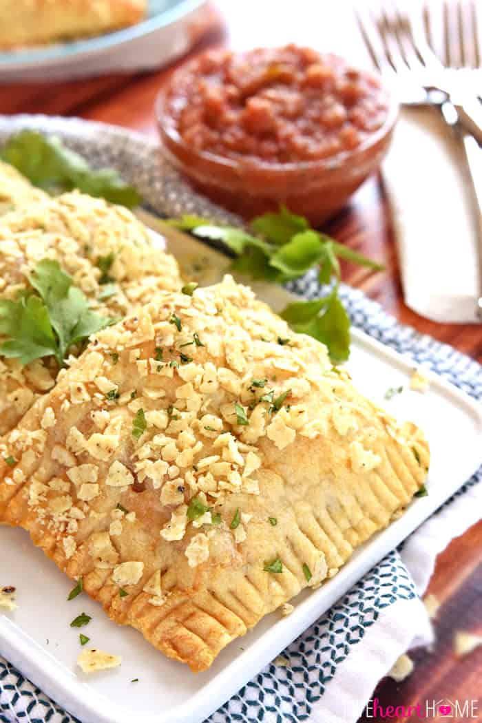 Creamy Chicken Taco Hand Pies on White Plate with Fresh Cilantro Garnish