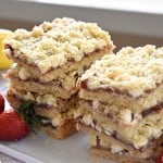 Strawberry Lemon Shortbread Bars with White Chocolate ~ feature a base of tender, buttery, lemon-infused shortbread topped with a layer of strawberry jam, a sprinkling of white chocolate chips, and a dusting of shortbread crumbs | FiveHeartHome.com