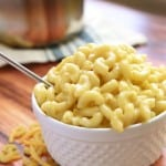 Homemade One-Pot Stovetop Macaroni and Cheese in a white bowl with a spoon