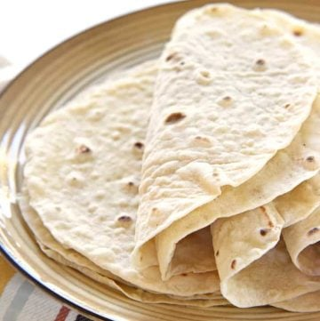 Easy Homemade Flour Tortillas ~ soft and tender homemade tortillas are deliciously versatile and surprisingly easy to make with just a few simple ingredients! | FiveHeartHome.com