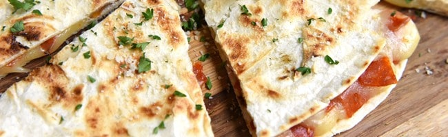 Pizza Quesadillas with Dipping Sauce ~ cheesy, melty quesadillas are stuffed with mozzarella and pepperoni and dipped in a flavorful, herb-infused, homemade pizza sauce for a fun, quick, and easy lunch idea!   FiveHeartHome.com