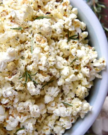 Rosemary Parmesan Popcorn ~ freshly-popped popcorn is drizzled with rosemary- and garlic-inflused olive oil and sprinkled with grated Parmesan, minced rosemary, garlic salt, and black pepper, making this recipe a flavorful snack for parties, munching, or movie watching!   FiveHeartHome.com