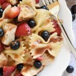 Chicken Berry Pasta Salad ~ a sweet and savory summer dish drizzled with fresh Strawberry Balsamic Vinaigrette...and with its red, white, and blue color scheme, it's the perfect recipe for 4th of July picnics, potlucks, and BBQs! | FIveHeartHome.com