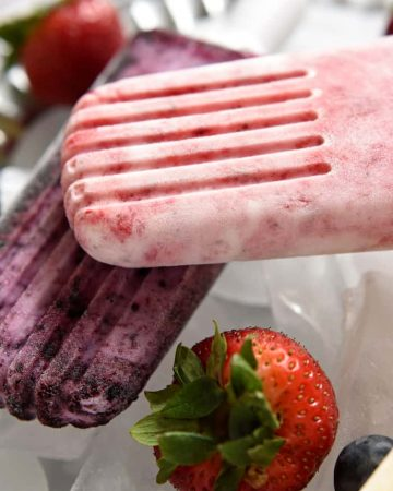 Close-up of Yogurt Popsicles in strawberry and bluebery flavors.