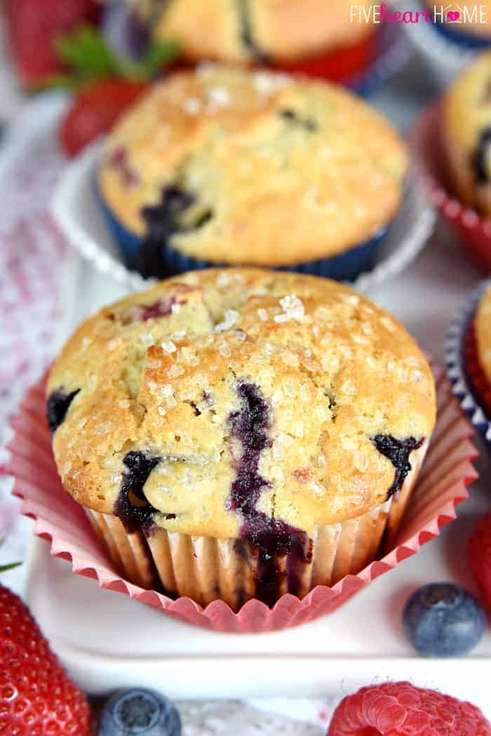 Mixed Berry Muffins on white platter with fresh fruit.