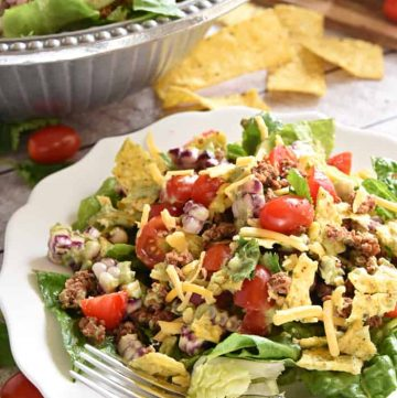 Ultimate Taco Salad ~ an explosion of contrasting flavors and textures, from spicy taco meat and velvety black beans to acidic tomatoes and crisp fresh corn, all topped with crunchy tortilla chips and a creamy, cilantro-flecked Avocado Ranch Dressing! | FiveHeartHome.com