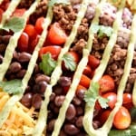 Ultimate Taco Salad ~ an explosion of contrasting flavors and textures, from spicy taco meat and velvety black beans to acidic tomatoes and crisp fresh corn, all topped with crunchy tortilla chips and a creamy, cilantro-flecked Avocado Ranch Dressing!   FiveHeartHome.com