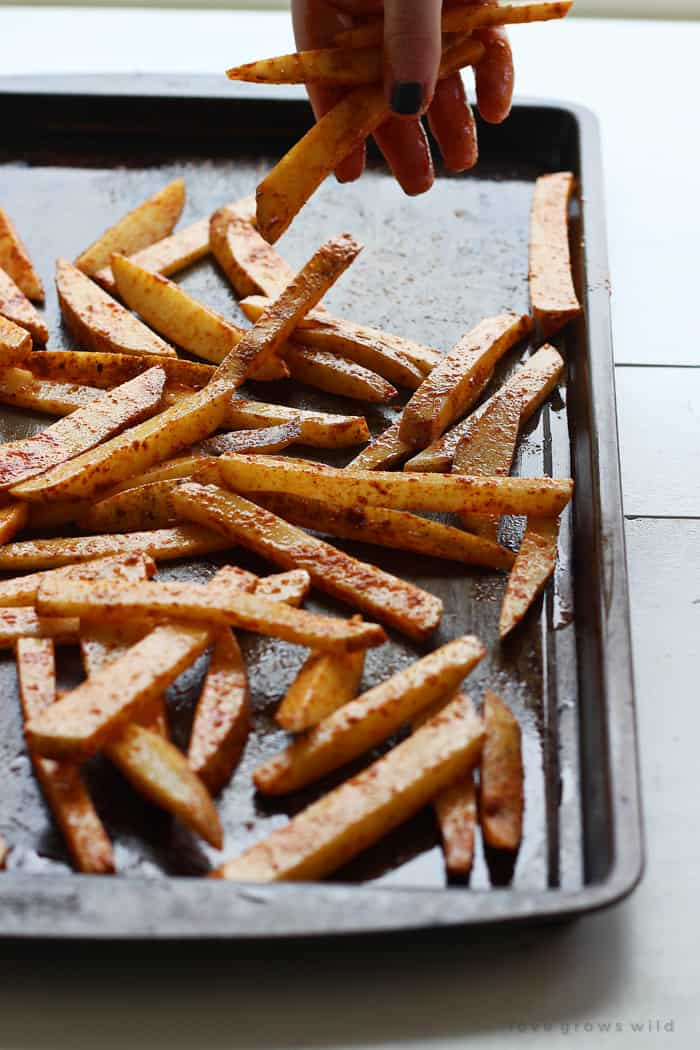 Baked Seasoned Fries ~ homemade French fries are coated with a delicious, spicy seasoning mix and then baked for a crispy, lightened-up side dish or snack! | LoveGrowsWild.com for FiveHeartHome.com