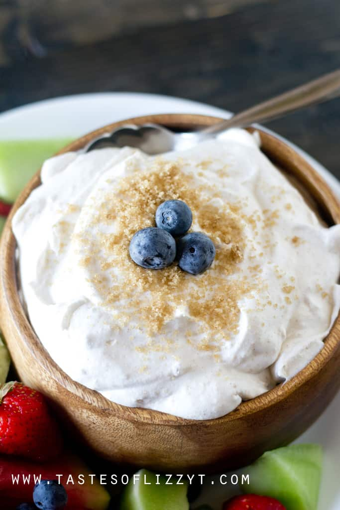 Brown Sugar Fruit Dip Close-Up Garnished with Fresh Blueberries and Brown Sugar