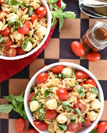 Caprese Orzo Salad ~ a vibrant summer pasta salad featuring juicy tomatoes, creamy balls of mozzarella, and ribbons of fresh basil, all topped off with a flavorful balsamic vinaigrette!   FiveHeartHome.com