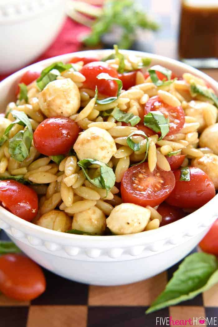 Caprese Orzo Salad in a white bowl