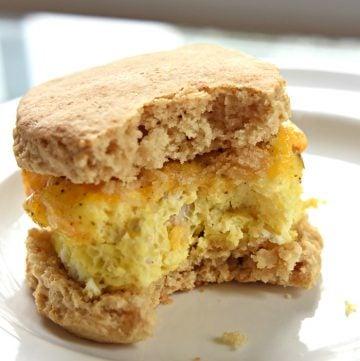Freezer Breakfast Sandwich on a plate with big bite missing.