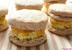 Easy Freezer Breakfast Sandwiches ~ cheesy scrambled eggs with ham are sandwiched inside of flaky biscuits in these make-ahead sandwiches, perfect for busy mornings and breakfast on-the-go! | FiveHeartHome.com