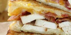 Garlic Cream Grilled Chicken & Bacon Paninis ~ piled with thin slices of grilled chicken, crispy bacon, and Colby Jack cheese, spread with a garlic cream sauce, and grilled until golden brown | DiaryofaRecipeCollector.com for FiveHeartHome.com