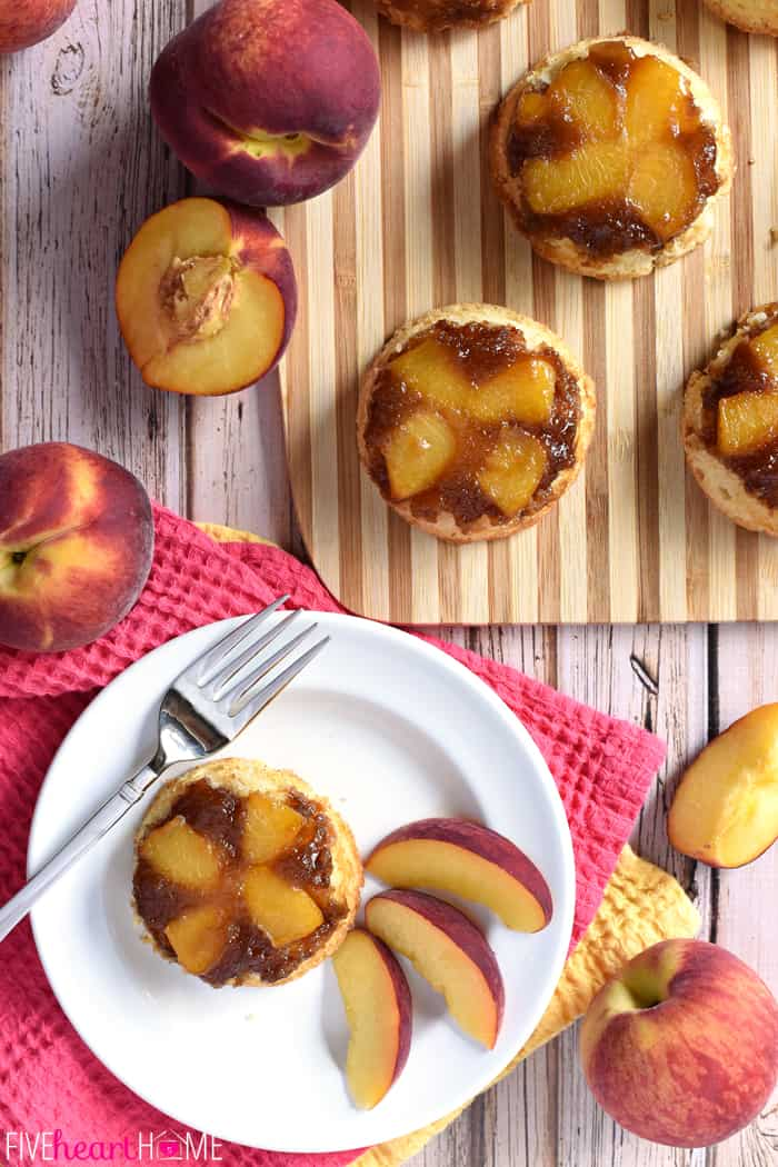 Peach Upside-Down Cupcakes Served on a White Plate with Fresh Sliced Peaches
