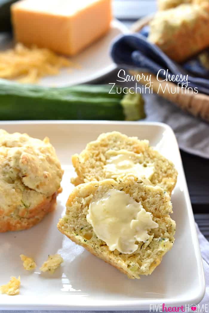 Savory Cheesy Zucchini Muffins are loaded with sharp cheddar and salty Parmesan, with bonus flavors of garlic and dill...warm out of the oven and slathered with butter, they'll become your new favorite way to enjoy garden-fresh zucchini! | FiveHeartHome.com