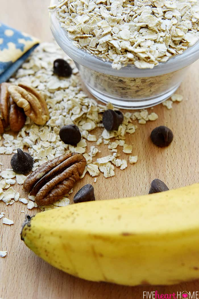 Banana Breakfast Cookies ingredients including overripe banana, oats, nuts, and chocolate chips.