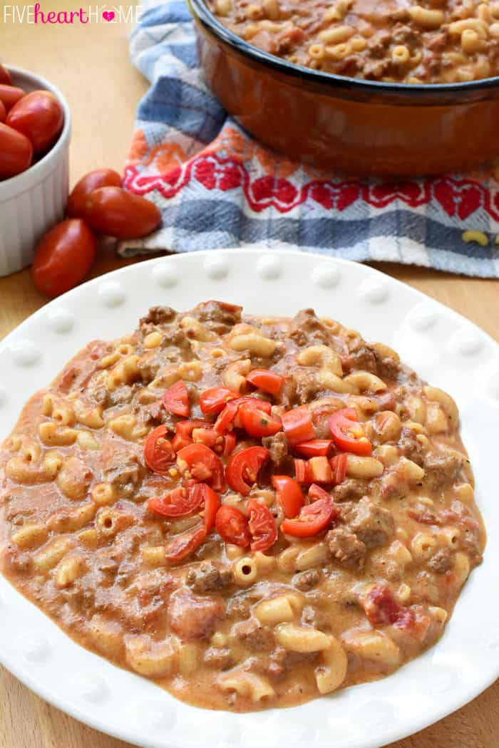 Hamburger Helper Recipe Served in White Bowl with Diced Tomatoes on Top