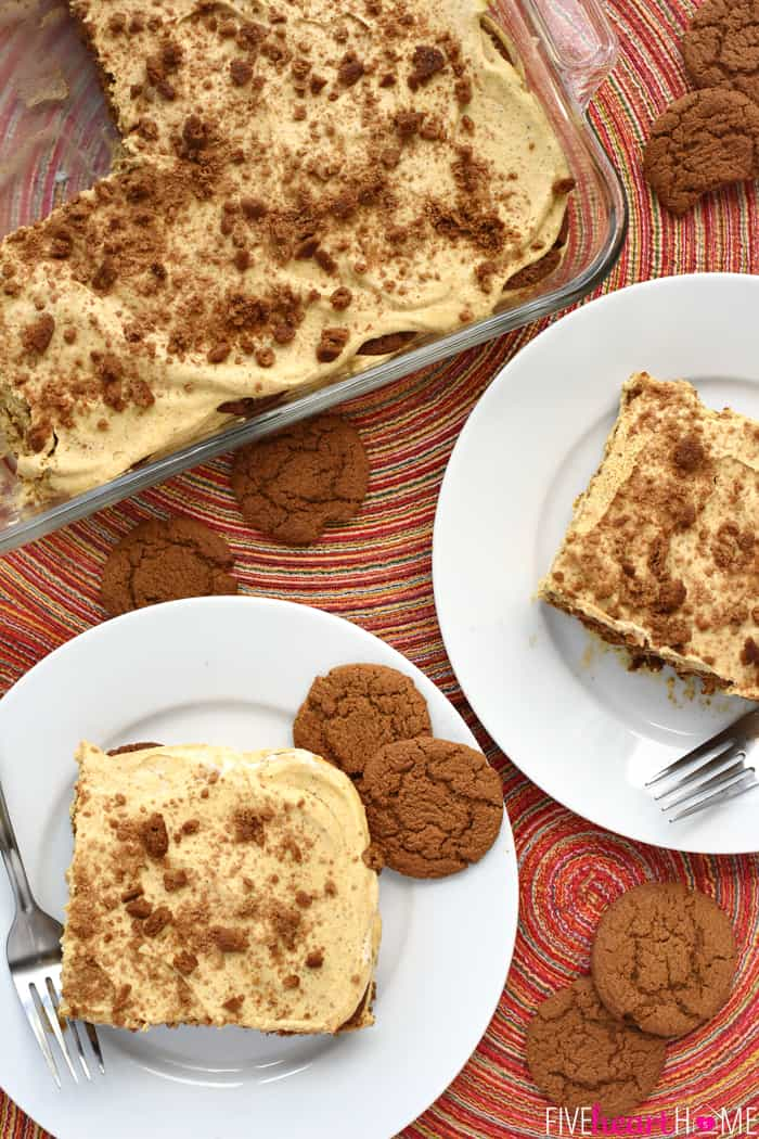 Aerial view of icebox cake in dish and on plates with gingersnaps scattered around