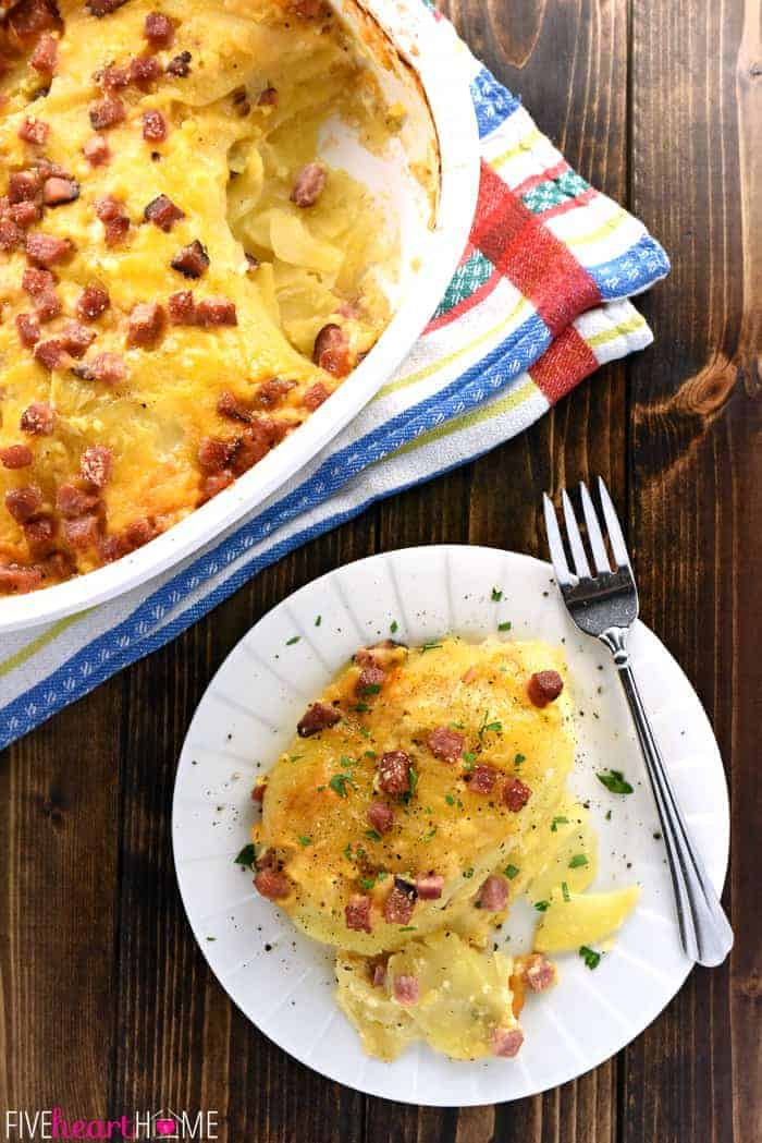 Cheesy Scalloped Potatoes with Ham ~ thin slices of potatoes drizzled with cream and layered with ham and cheddar for a decadent comfort food recipe that's also a great way to use up leftover holiday ham! | FiveHeartHome.com