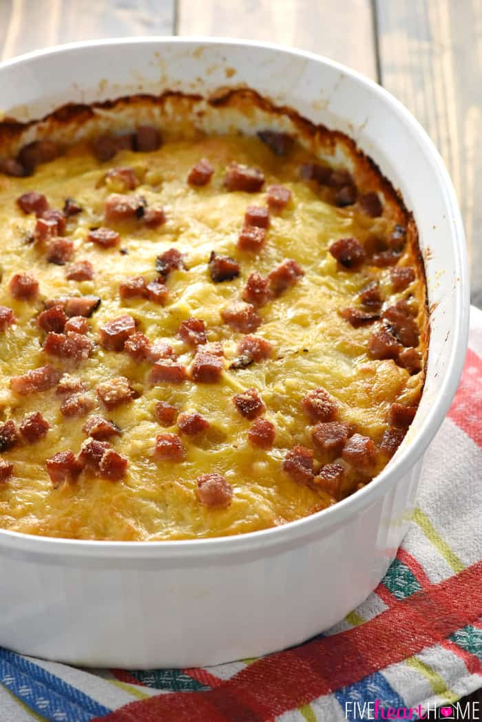 Cheesy Scalloped Potatoes with Ham in Oval White Baking Dish