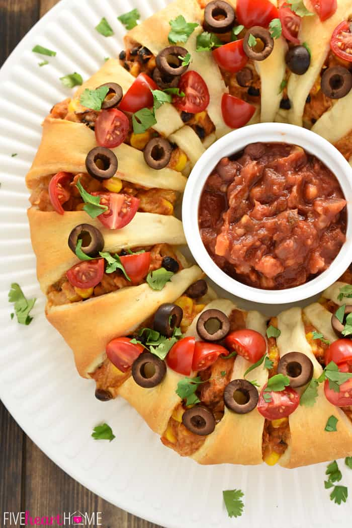 Aerial View of Chicken or Turkey Taco Crescent Ring on Round Platter with Dish of Salsa in the Middle