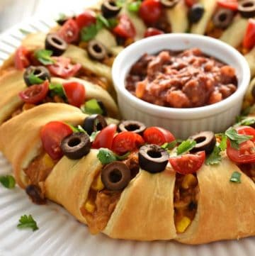 Chicken or Turkey Taco Crescent Ring ~ a delicious way to use up leftover chicken or holiday turkey...mixed with black beans, corn, and cream cheese, flavored with taco seasoning, and wrapped in light, flaky crescent roll dough for an easy yet impressive appetizer or dinner! | FiveHeartHome.com