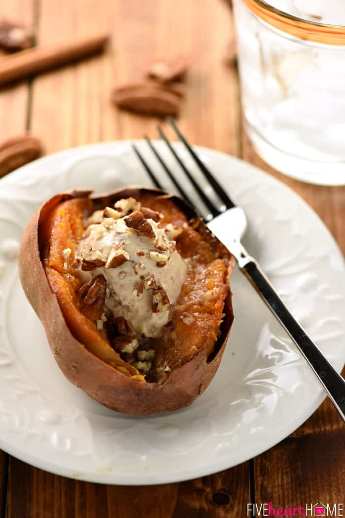 Sweet Potato Cut Down the Middle with Butter and Pecan Garnish